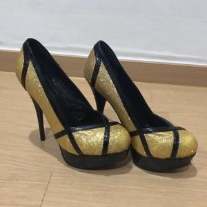Gold with black trim platform bottom 6in heels.
